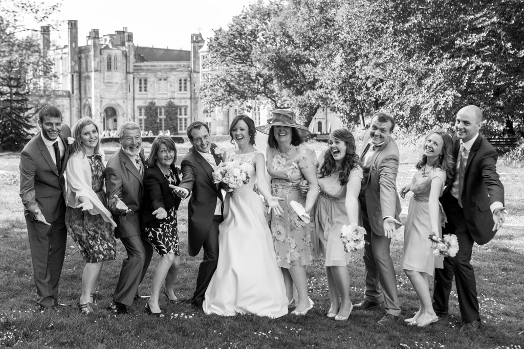 Highcliffe castle wedding candid group shot