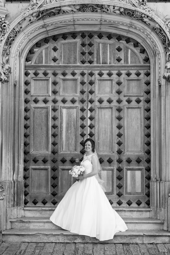 Bride infront of large front door at Highcliffe castle