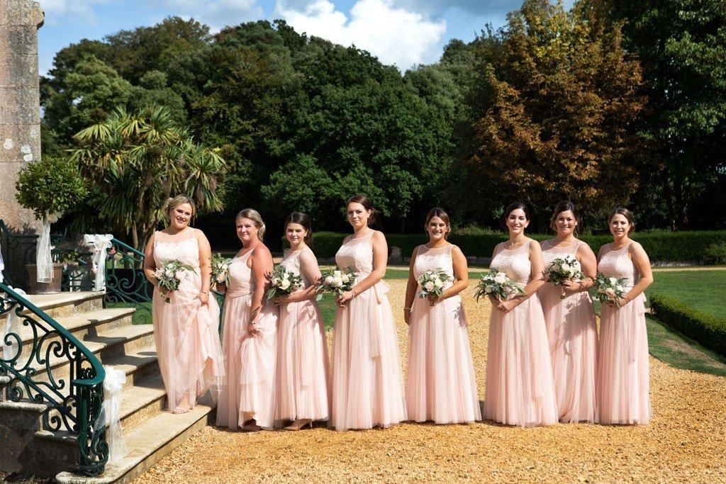 Bridesmaids entering ceremony room at a Highcliffe castle wedding